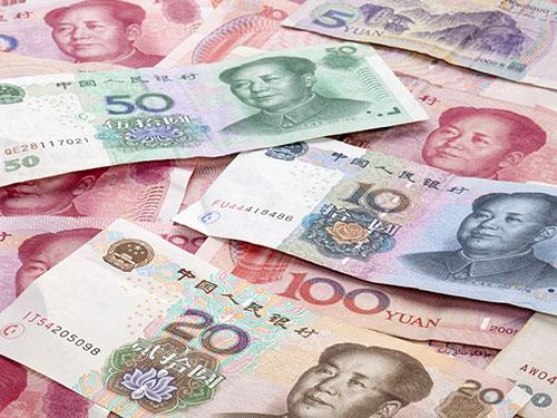 Nhân dân tệ là ngoại tệ chưa được tự do chuyển đổi nên khi thanh toán bằng đồng tiền này, doanh nghiệp dễ gặp rủi ro Ảnh: PHONG LAN
