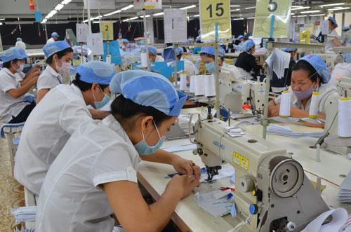 Sản xuất hàng xuất khẩu tại Công ty CP May Việt Tiến Ảnh: Tấn Thạnh