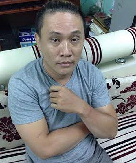 Tú ông Lê Bảo Lộc lúc nghe lệnh bắt  Ảnh: HẠNH DUYÊN