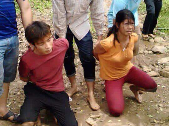 Chị Nguyễn Thị Hán lúc mới bị bắt cùng nghi can Đặng Văn Hùng lúc 10 giờ 30 ngày 15-8 - Ảnh: Báo Yên Bái