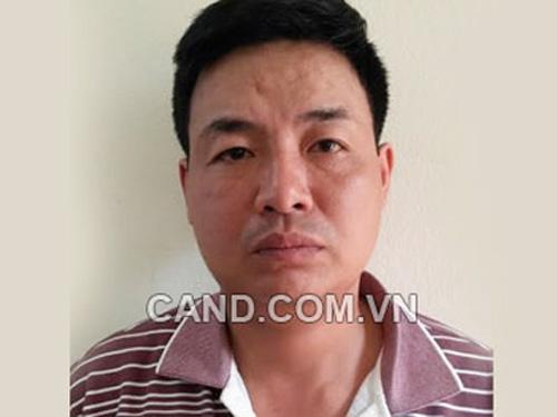 Nghi phạm đánh vợ tử vongVũ Trung Hiếu tại cơ quan công an - Ảnh: CAND