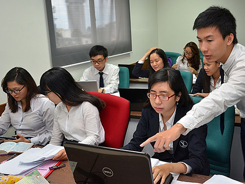 Tranh chấp tại Trường ĐH Hoa Sen là một trong những điểm nóng của giáo dục ĐH năm 2014.  Trong ảnh: Sinh viên Trường ĐH Hoa Sen trong giờ học Ảnh: Tấn Thạnh