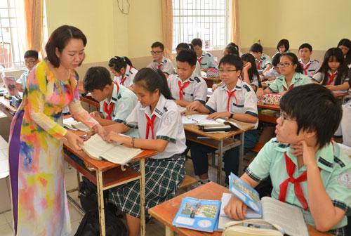 Đề thi văn cần giúp học sinh yêu môn văn hơn. Trong ảnh: Học sinh lớp 9 tại một trường THCS ở TP HCM trong giờ học văn Ảnh: TẤN THẠNH