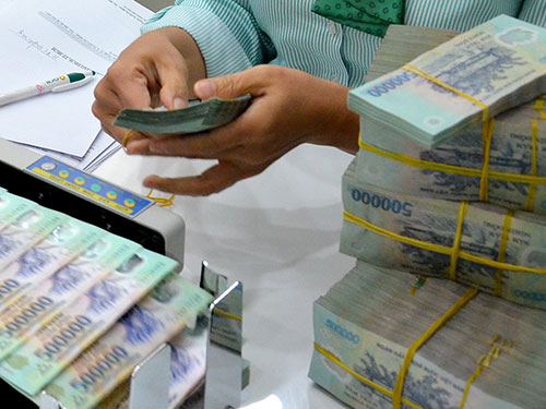 Viện Nghiên cứu Kinh tế và Chính sách khuyến nghị Ngân hàng Nhà nước nên chủ động phá giá tiền đồng từ 3%-4% trong vòng 2-3 năm tới Ảnh: Tấn Thạnh