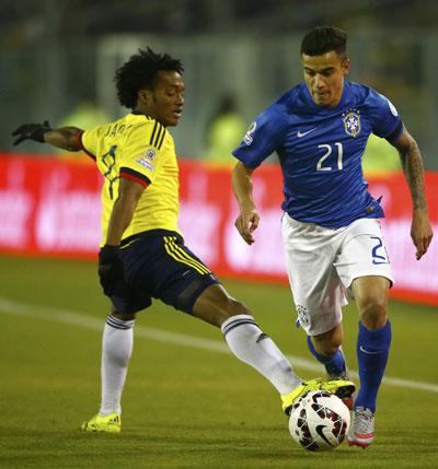 Coutinho (phải), một trong những niềm hy vọng của Brazil ở trận gặp Venezuela rạng sáng 22-6 Ảnh: REUTERS