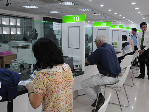 Vietcombank đang khiến thị trường tài chính chú ý khi muốn tìm một đối tác sáp nhập tự nguyệnẢnh: HỒNG THÚY