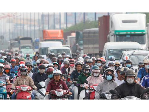 Quy định về thu phí sử dụng đường bộ đối với xe máy không được sự đồng thuận của người dân sẽ được Bộ Giao thông Vận tải đề xuất dừng Ảnh: HOÀNG TRIỀU