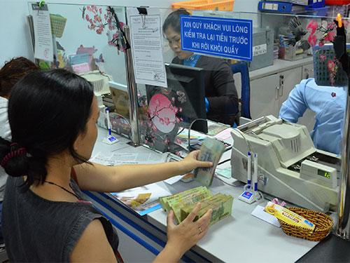 Nếu thanh toán trực tiếp bằng nội tệ 2 nước, doanh nghiệp sẽ tiết kiệm được chi phí Ảnh:Tấn Thạnh
