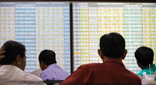 Thị trường chứng khoán đang tăng điểm mạnh trở lại  Ảnh: Hoàng Triều