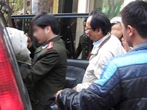 Hồ Văn Hải (giữa) bị cơ quan An ninh điều tra Bộ Công an bắt giữ hồi tháng 1-2014