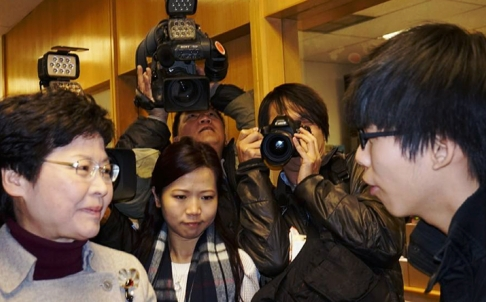 Joshua Wong (right) confronts Chief Secretary Carrie Lam. Photo: Commercial Radio Facebook page (facebook.com/881onaclearday)