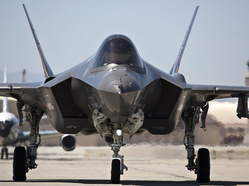 An F-35 fighter taxis at Edwards Air Force base, in 2012. The cutbacks in U.K. will be offset by new forces needed for the aircrafts deployment to RAF Lakenhealth.