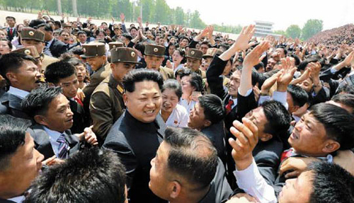 North Korean leader Kim Jong-un is surrounded by people as he attends a young leaders' rally in Pyongyang in this picture published in the official Rodong Sinmun daily on Sunday.