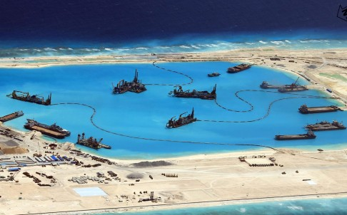 China has defended its work on islands in the Spratlys chain, saying the construction and land reclamation is designed to improve weather forecasts. Photo: EPA