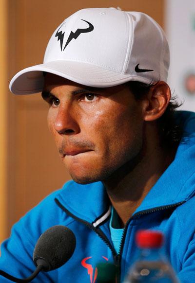 Nadal tụt xuống hạng 10 sau khi không bảo vệ được chức vô địch Pháp mở rộng Ảnh: REUTERS