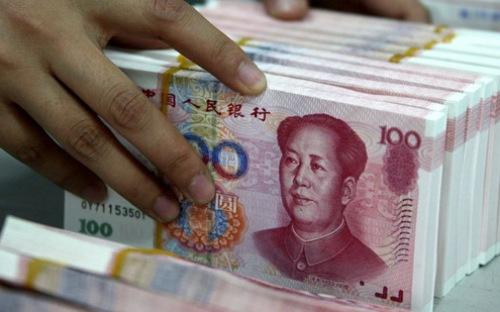 """Đối với các nước hiện đang có quan hệ thương mại với Trung Quốc, việc đồng Nhân dân tệ yếu đi sẽ """"làm khó"""" họ - Ảnh: RT."""