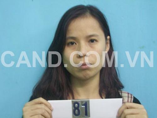 Nữ cán bộ Sở Xây dựng Đinh Thị Hương Thùy sau khi bị bắt giữ tại cơ quan công an - Ảnh: CAND