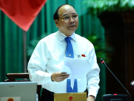 Phó Thủ tướng Nguyễn Xuân Phúc trực tiếp trả lời chất vấn của đại biểu Quốc hội vào buổi sáng ngày 13-6. Ảnh: Phó Thủ tướng Nguyễn Xuân Phúc trả lời chất vấn của đại biểu Quốc hội tháng 6-2014