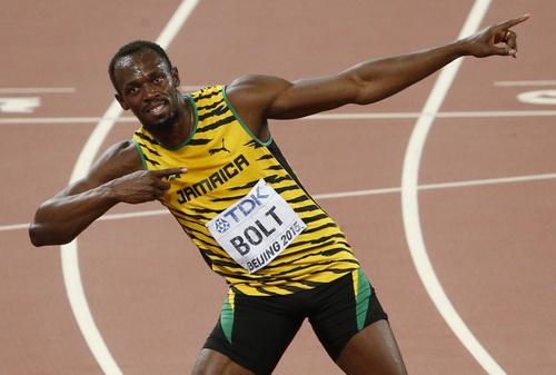 Hình ảnh vui mừng chiến thắng quen thuộc của Usain Bolt được tái hiện trên sân Bắc Kinh sau 7 năm.