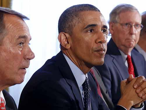 Tổng thống Mỹ Barack Obama và các nhà lãnh đạo quốc hội tại cuộc gặp hồi tháng 11-2014 Ảnh: Reuters