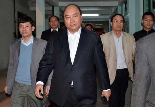 Phó Thủ tướng Nguyễn Xuân Phúc đến thăm ông Nguyễn Bá Thanh tối 13-1