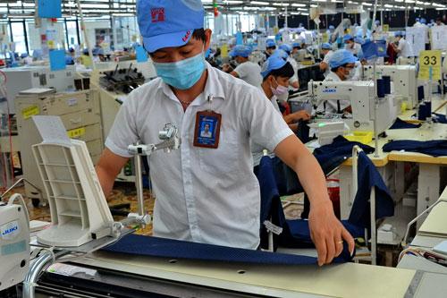 Ngành may mặc được kỳ vọng sẽ tăng trưởng mạnh khi Hiệp định Đối tác xuyên Thái Bình Dương (TPP) có hiệu lực - Ảnh: Tấn Thạnh