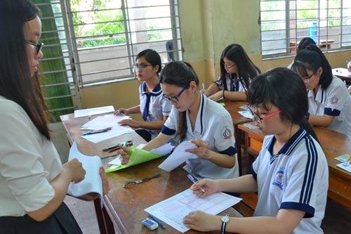 Học sinh làm bài thi trong kỳ thi THPT quốc gia 2016 Ảnh: Tấn Thạnh