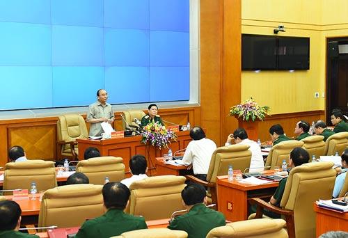 Thủ tướng Nguyễn Xuân Phúc làm việc với Bộ Quốc phòng vào chiều 21-9 Ảnh: QUANG HIẾU
