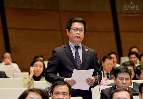 Đại biểu Vũ Tiến Lộc, Chủ tịch VCCI, nêu ý kiến đóng góp kế hoạch tái cơ cấu nền kinh tế giai đoạn 2016-2020. Ảnh: VĂN DUẨN