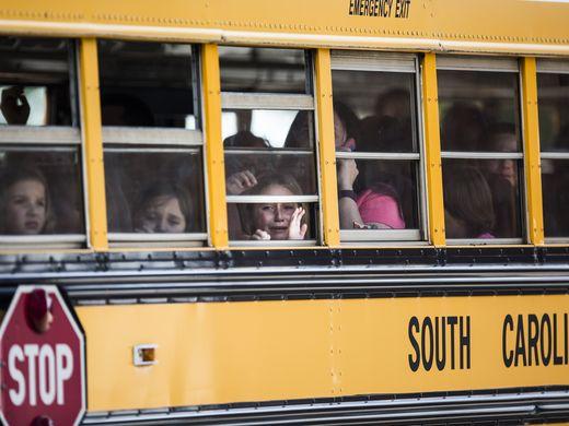 Các học sinh được đưa đến một nhà thờ gần trường để gặp cha mẹ. Ảnh: Independent Mail