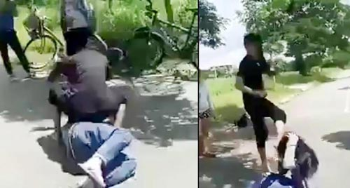 Cảnh Nhí Tino và nữ sinh H. đánh đập dã man em U. (Ảnh từ clip)