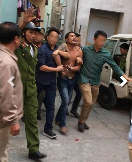 Nam thanh niên đập phá ở nghĩa trang và chém bị thương cảnh sát hình sự khi bị khống chế - ảnh: Facebook