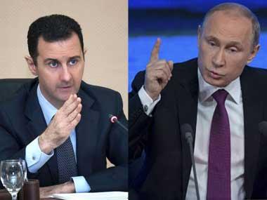 Hình ảnh Tổng thống Assad tại quảng trường Saadallah al-Jabri ở Aleppo chụp hôm 17-12. Ảnh: Reuters