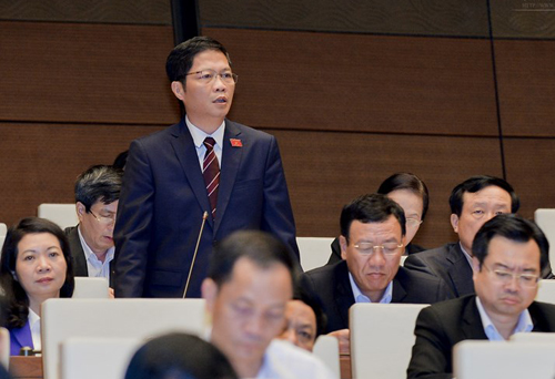 Bộ trưởng Bộ Công Thương Trần Tuấn Anh trong một lần phát biểu tại hội trường QH - Ảnh: Quochoi.vn