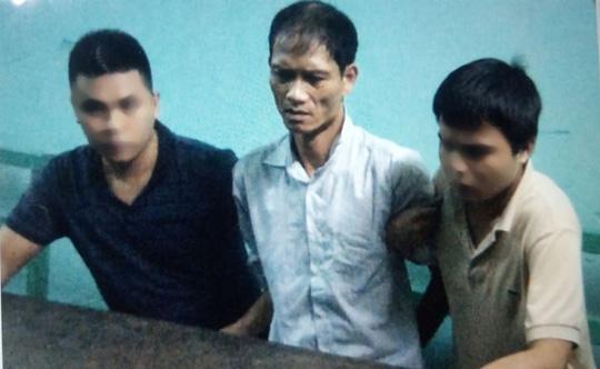 Nghi phạm Doãn Trung Dũng khi bị bắt giữ