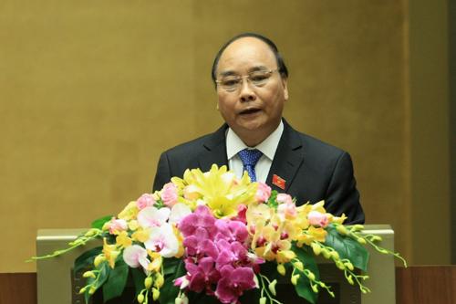 Thủ tướng Nguyễn Xuân Phúc trình bày báo cáo trước QH sáng 17-11 - Ảnh: chinhphu.vn