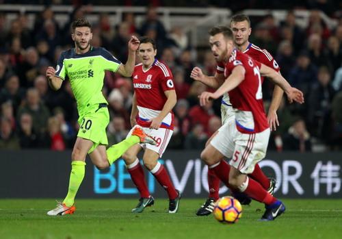 Lallana (trái) lập cú đúp trong chiến thắng 3-0 của Liverpool