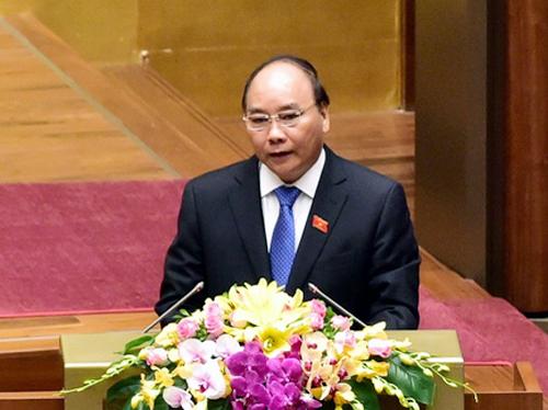 Thủ tướng Nguyễn Xuân Phúc trình bày báo cáo kinh tế-xã hội trước Quốc hội trong phiên khai mạc ngày 20-10