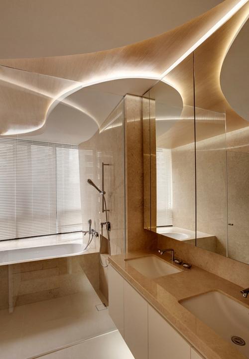 Đèn được bố trí dưới các lớp thạch cao, gỗ tạo nên ánh sáng lung linh, dịu nhẹ.