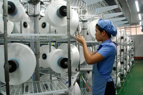 Ngành dệt may Việt Nam chủ yếu là gia công, giá trị gia tăng thấpẢnh: Tấn Thạnh