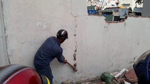 Cưỡng chế phá dỡ bức tường nhà số 12 Nguyễn Thị Minh Khai