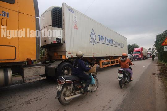 Container, xe tải nặng sẽ không được đi đường cao tốc 18.000 tỉ đồng? - Ảnh 1.