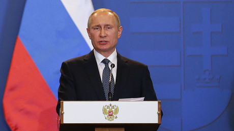 Tổng thống Vladimir Putin tố Ukraine giả làm nạn nhân để vòi tiền. Ảnh: RT
