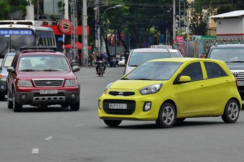 Taxi công nghệ phát triển nhanh khiến các hãng taxi truyền thống lo lắng trong khi nhà nước lại lúng túng trong quản lý Ảnh: Tấn Thạnh