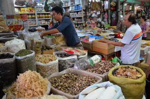 Hộ kinh doanh được lợi nhiều hơn khi chuyển thành doanh nghiệp Ảnh: Tấn Thạnh