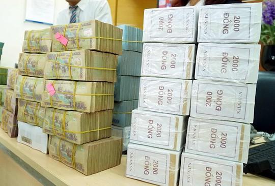 Ngân hàng Nhà nước cam kết không thiếu tiền mặt dịp Tết 2018 - Ảnh 1.