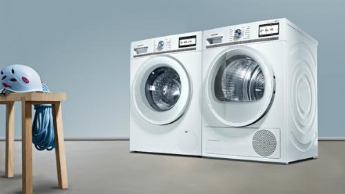 Cách tiết kiệm điện khi giặt, sấy mùa mưa - Ảnh 1.