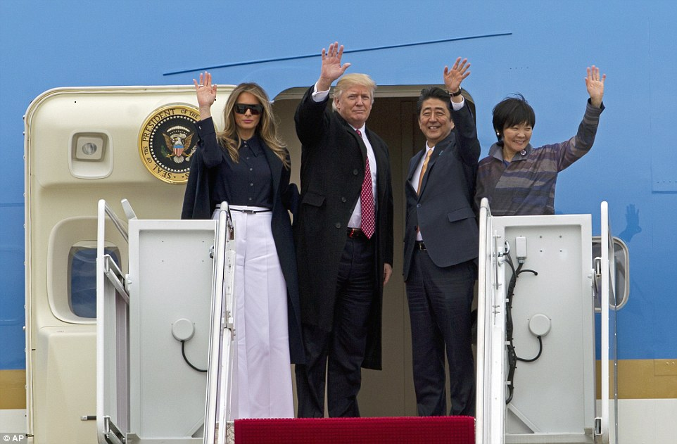 LETS GO TO FLORIDA: President Donald Trump and Japanese Prime Minister Shinzo Abe, accompanied by their wives, first lady Melania Trump and Akie Abe, wave before boarding Air Force One at Andrews Air Force Base