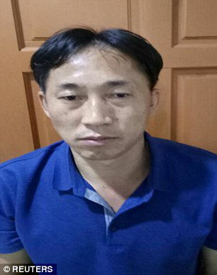 Nghi phạm tên Ri Jong-chol bị bắt giữ vào ngày 17-2 tại nhà riêng. Ảnh: REUTERS