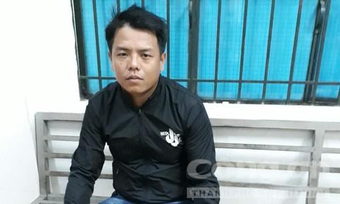 Bắt đối tượng truy nã nguy hiểm tại quận Bình Tân - Ảnh 1.